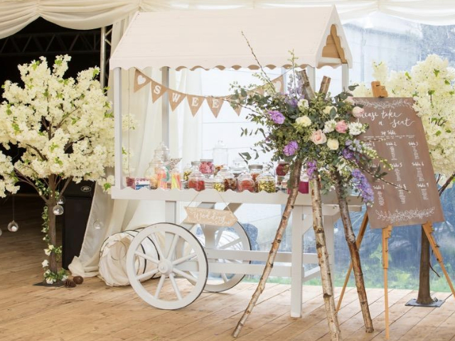 Sweet cart and flower arrangement in Marquee at Hockwold Hall